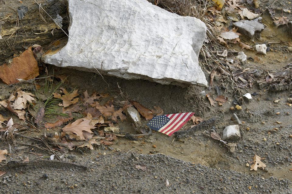 Flag And Rock On The Ground